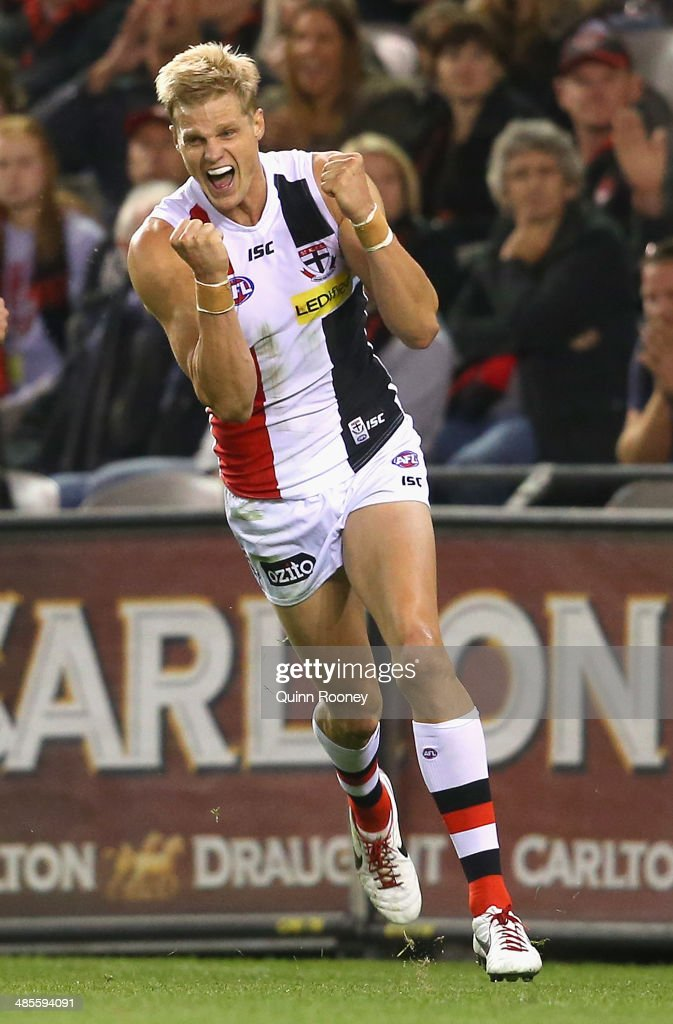 <a gi-track='captionPersonalityLinkClicked' href=/galleries/search?phrase=Nick+Riewoldt&family=editorial&specificpeople=176552 ng-click='$event.stopPropagation()'>Nick Riewoldt</a> of the Saints celebrates kicking a goal during the round five AFL match between the Essendon Bombers and the St Kilda Saints at Etihad Stadium on April 19, 2014 in Melbourne, Australia.