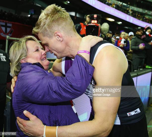 Nick Riewoldt of the Saints celebrates the win with mum Fiona Riewoldt during the round 16 AFL match between the St Kilda Saints and the Richmond...