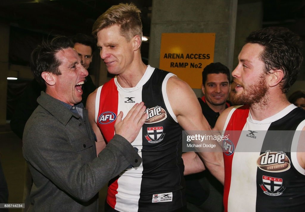 Nick Riewoldt of the Saints celebrates with former teammate Stephen Milne after winning during the round 22 AFL match between the St Kilda Saints and the North Melbourne Kangaroos at Etihad Stadium on August 20, 2017 in Melbourne, Australia.