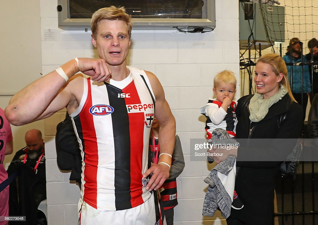 Nick Riewoldt of the Saints celebrates with his wife Catherine Heard and son James Riewoldt after winning the round 22 AFL match between the Richmond...