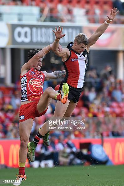 Nick Riewoldt of the Saints competes for the ball against Matt Rosa of the Suns during the round 15 AFL match between the Gold Coast Suns and the St...