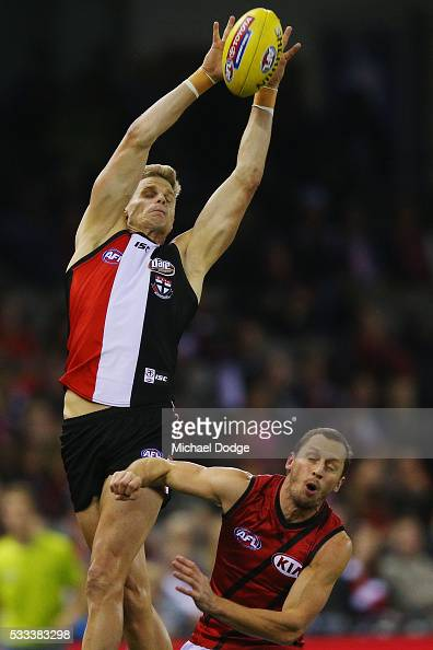 Nick Riewoldt of the Saints competes for the ball over James Kelly of the Bombers during the round nine AFL match between the St Kilda Saints and the...