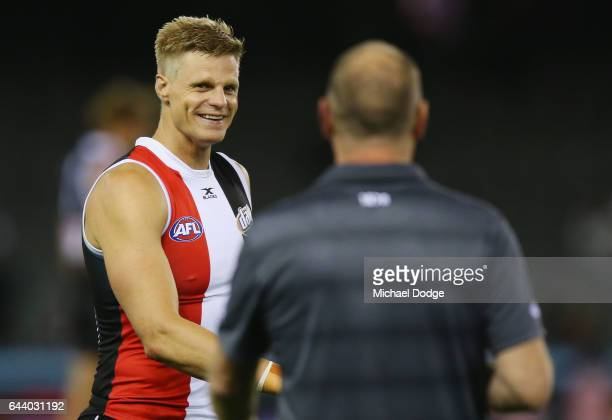 Nick Riewoldt of the Saints has a word to Power head coach Ken Hinkley at at three quarter time during the JLT Community Series AFL match between the...