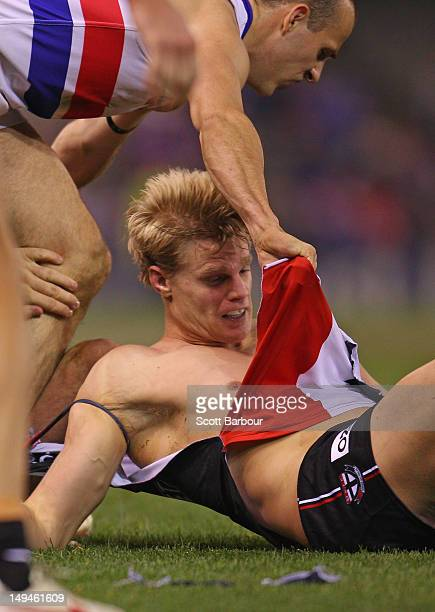 Nick Riewoldt of the Saints has his jumper ripped off during the round 18 AFL match between the St Kilda Saints and the Western Bulldogs at Etihad...