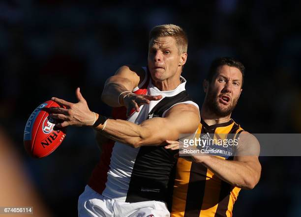 Nick Riewoldt of the Saints is challenged by James Frawley of the Hawks during the round six AFL match between the Hawthorn Hawks and the St Kilda...