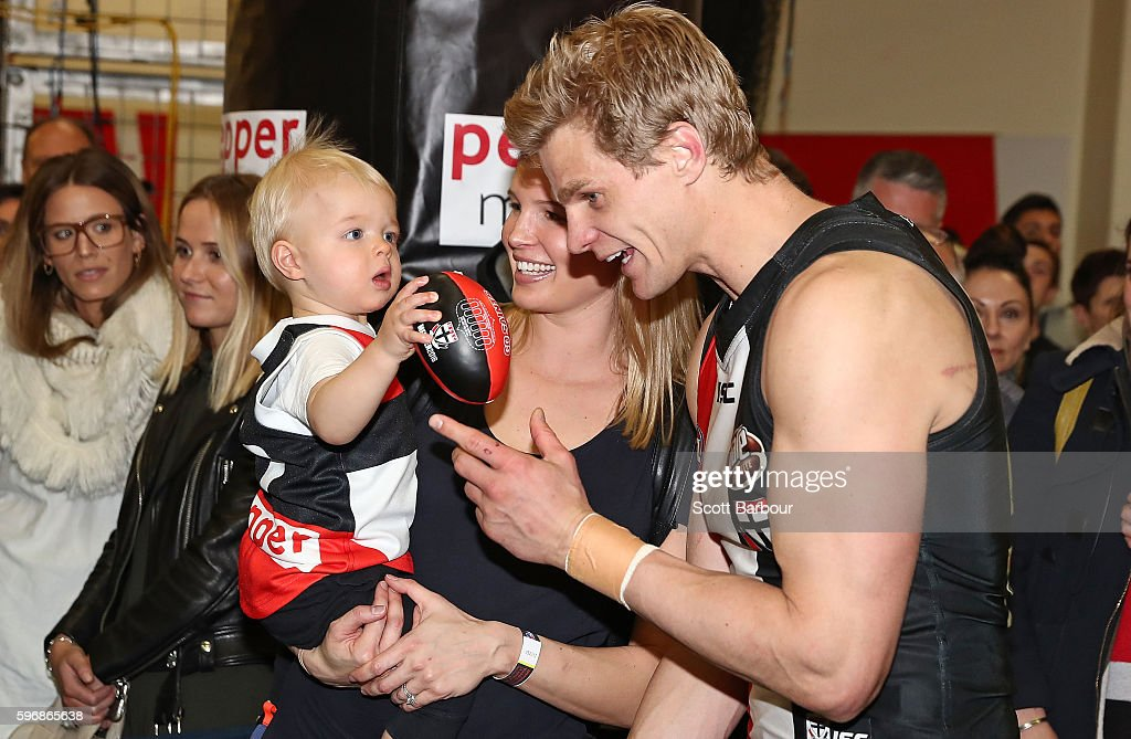 Nick Riewoldt of the Saints is congratulated by his wife Catherine Heard and son James Riewoldt after winning the round 23 AFL match between the St...