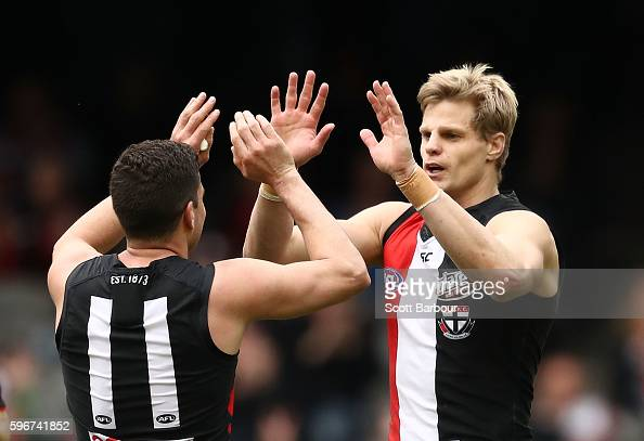 Nick Riewoldt of the Saints is congratulated by Leigh Montagna of the Saints after kicking a goal during the round 23 AFL match between the St Kilda...