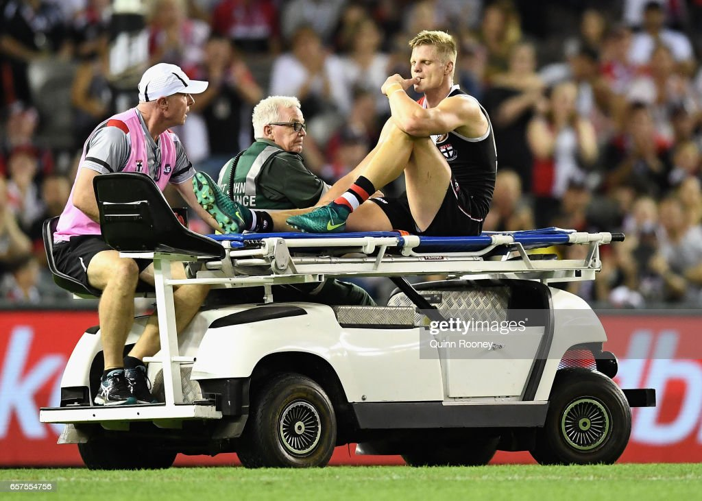 Nick Riewoldt of the Saints is stretchered off the ground after hurting his knee during the round one AFL match between the St Kilda Saints and the Melbourne Demons at Etihad Stadium on March 25, 2017 in Melbourne, Australia.