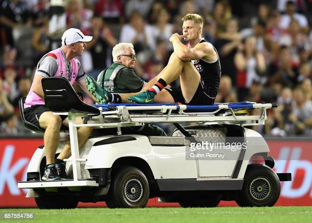 Nick Riewoldt of the Saints is stretchered off the ground after hurting his knee during the round one AFL match between the St Kilda Saints and the...