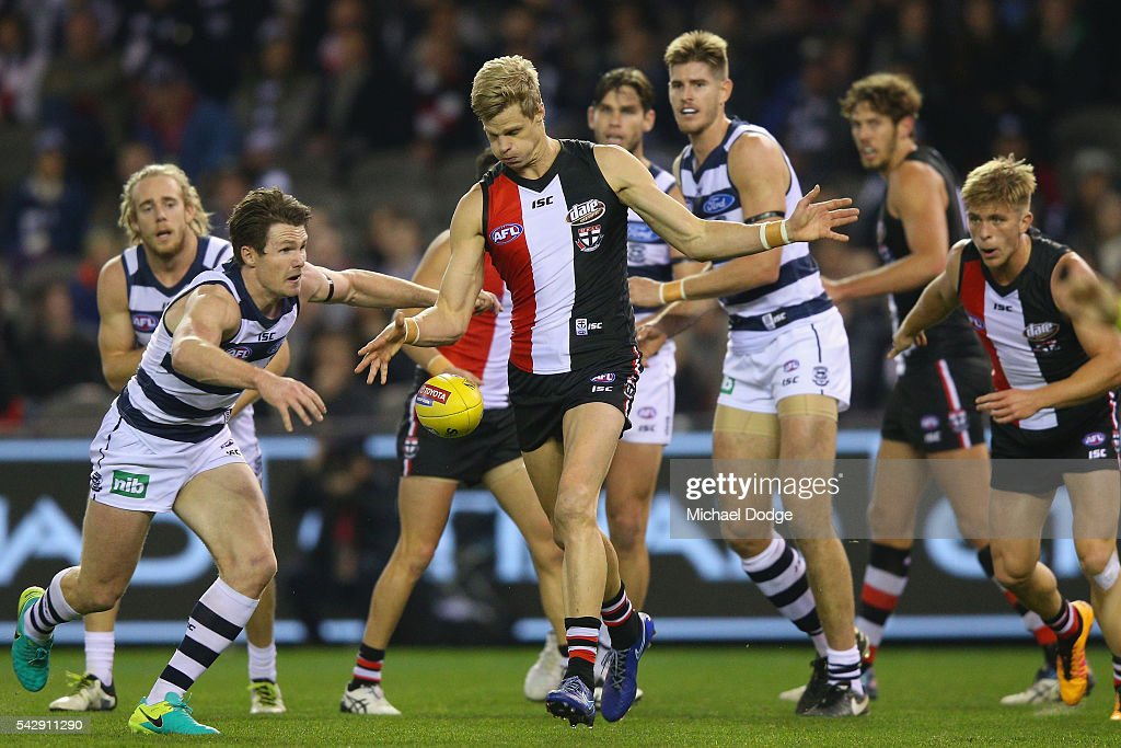 <a gi-track='captionPersonalityLinkClicked' href=/galleries/search?phrase=Nick+Riewoldt&family=editorial&specificpeople=176552 ng-click='$event.stopPropagation()'>Nick Riewoldt</a> of the Saints kicks the ball away from Patrick Dangerfield of the Cats during the round 14 AFL match between the St Kilda Saints and the Geelong Cats at Etihad Stadium on June 25, 2016 in Melbourne, Australia.