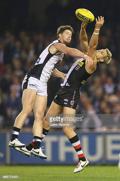 Nick Riewoldt of the Saints marks infront of Sam Rowe of the Blues during the round eight AFL match between the St Kilda Saints and the Carlton Blues...