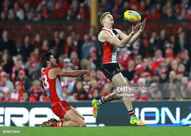 Nick Riewoldt of the Saints marks over Lewis Melican of the Swans during the round 18 AFL match between the Sydney Swans and the St Kilda Saints at...