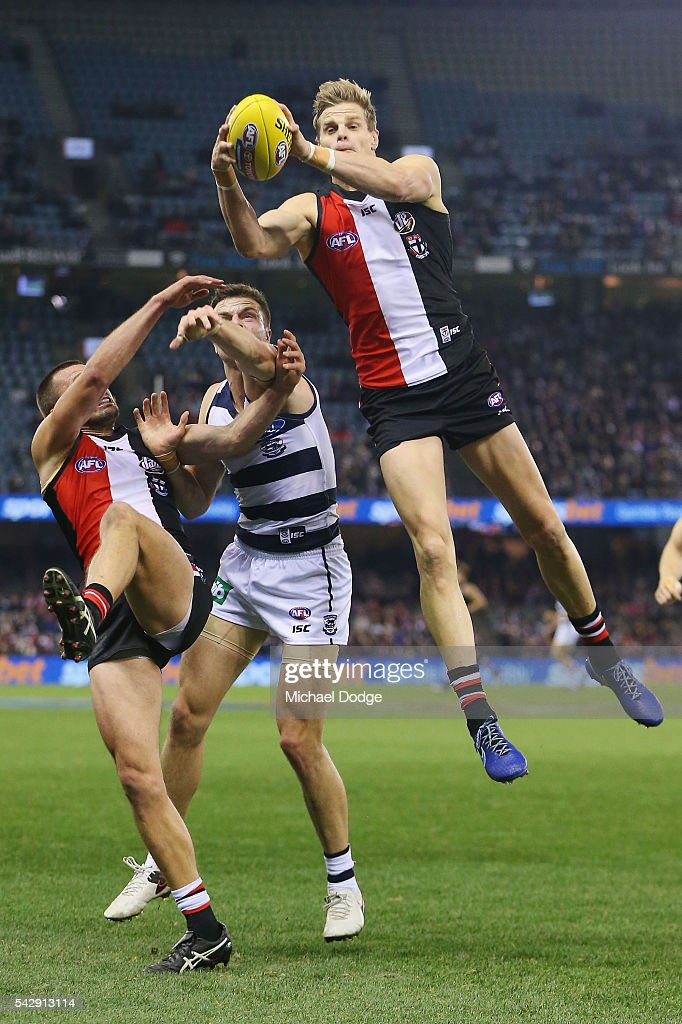 Nick Riewoldt of the Saints marks the ball against Jordan Murdoch of the Cats during the round 14 AFL match between the St Kilda Saints and the Geelong Cats at Etihad Stadium on June 25, 2016 in Melbourne, Australia.