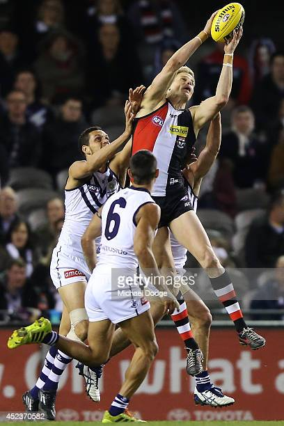 Nick Riewoldt of the Saints marks the ball against Michael Johnson of the Dockers during the round 18 AFL match between the St Kilda Saints and the...
