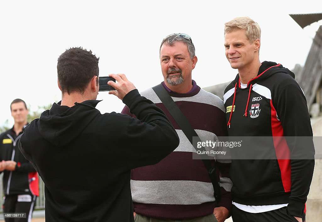 <a gi-track='captionPersonalityLinkClicked' href=/galleries/search?phrase=Nick+Riewoldt&family=editorial&specificpeople=176552 ng-click='$event.stopPropagation()'>Nick Riewoldt</a> of the Saints poses for photos with fans during a St Kilda Saints AFL media session on April 23, 2014 in Wellington, New Zealand.