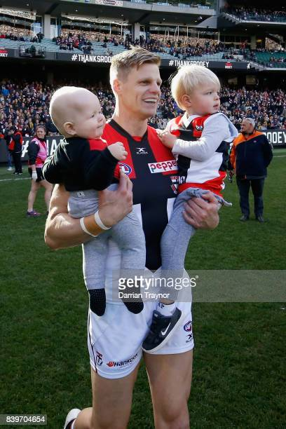 Nick Riewoldt of the Saints runs onto the ground with his sons William and James before the round 23 AFL match between the Richmond Tigers and the St...