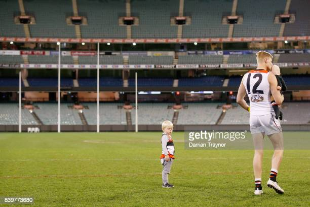 Nick Riewoldt of the Saints takes a last walk on the MCG with his sons James and William after the round 23 AFL match between the Richmond Tigers and...