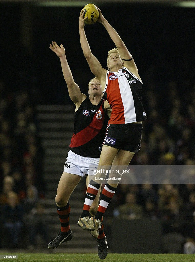 Nick Riewoldt of the Saints takes a mark over Sean Wellman of the Bombers during the round 14 AFL match between the St Kilda Saints and the Essendon...