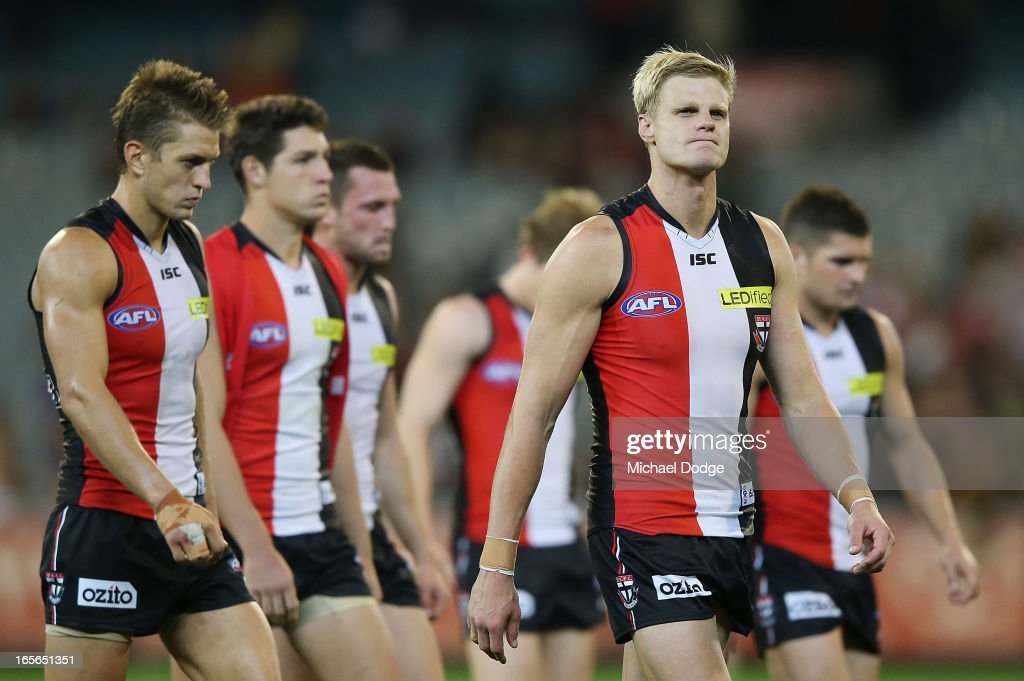<a gi-track='captionPersonalityLinkClicked' href=/galleries/search?phrase=Nick+Riewoldt&family=editorial&specificpeople=176552 ng-click='$event.stopPropagation()'>Nick Riewoldt</a> of the Saints walks off after losing during the round two AFL match between the St Kilda Saints and the Richmond Tigers at Melbourne Cricket Ground on April 5, 2013 in Melbourne, Australia.