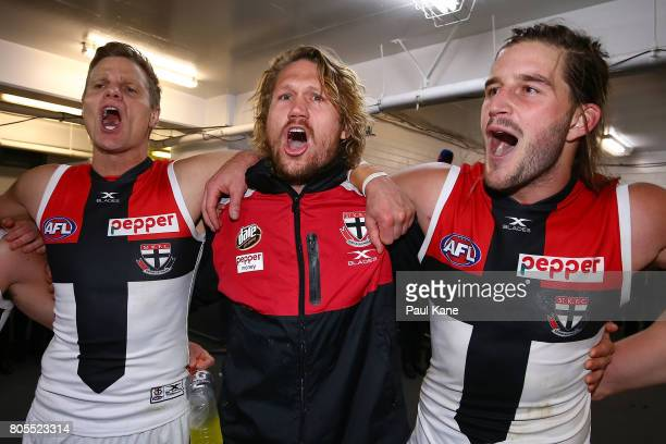 Nick Riewoldt Sam Gilbert and Josh Bruce of the Saints celebrate winning the round 15 AFL match between the Fremantle Dockers and the St Kilda Saints...