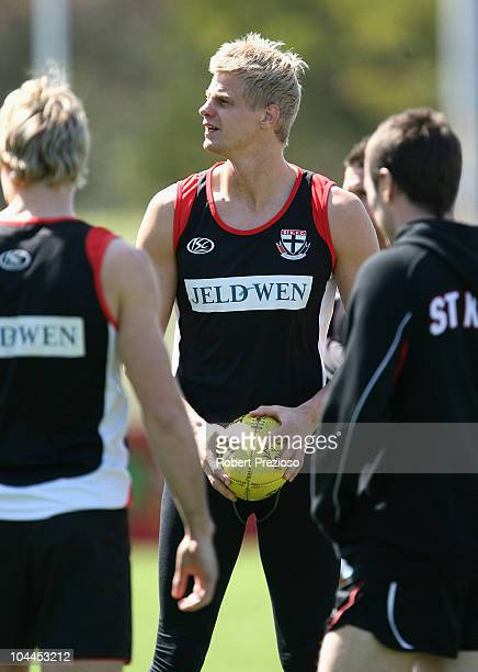 Nick Riewoldt warms up with teammates during a St Kilda Saints AFL recovery session at Linen House Oval on September 26 2010 in Melbourne Australia