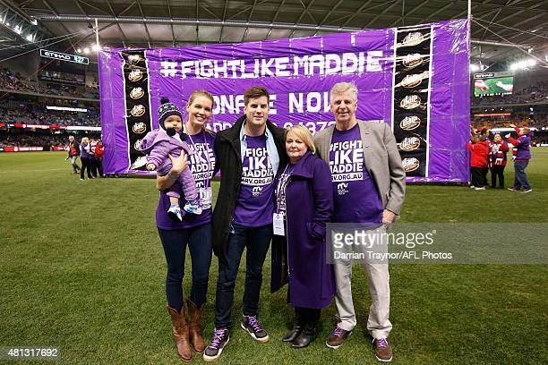 Nick Riewoldt's son James wife Catherine brother Alex Mother Fiona and father Joe pose for a photo in front of the St Kilda banner before the round...