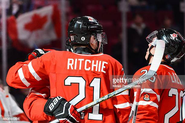 Nick Ritchie of Team Canada celebrates his goal with teammates during the 2015 IIHF World Junior Hockey Championship exhibition game against Team...