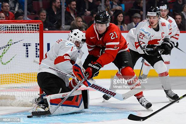 Nick Ritchie of Team Canada gets around goaltender Ludovic Waeber of Team Switzerland and scores during the 2015 IIHF World Junior Hockey...