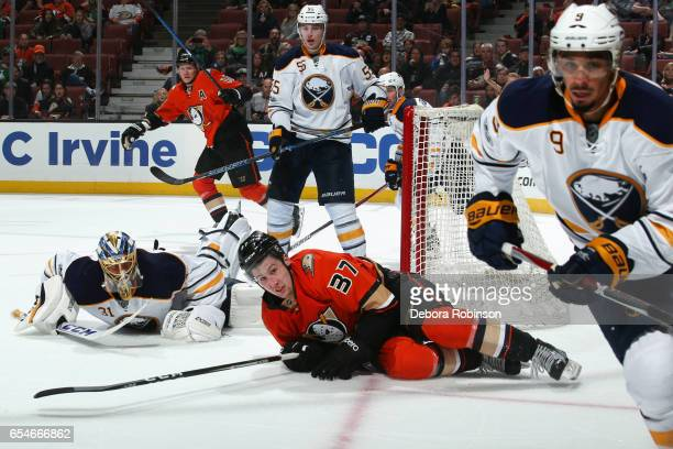 Nick Ritchie of the Anaheim Ducks battles against Anders Nilsson Rasmus Ristolainen and Evander Kane of the Buffalo Sabres during the game on March...