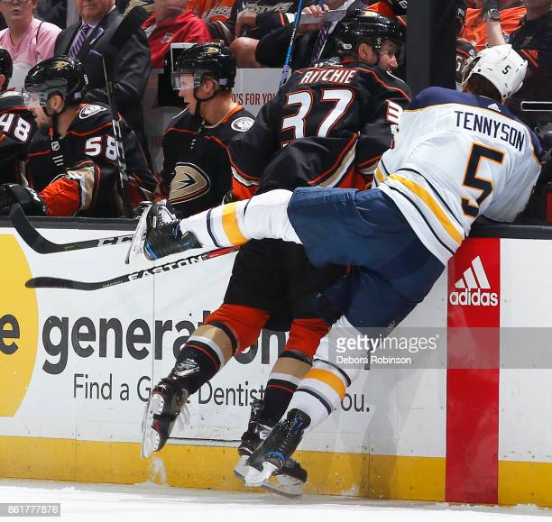 Nick Ritchie of the Anaheim Ducks battles against Matt Tennyson of the Buffalo Sabres during the game on October 15 2017 at Honda Center in Anaheim...