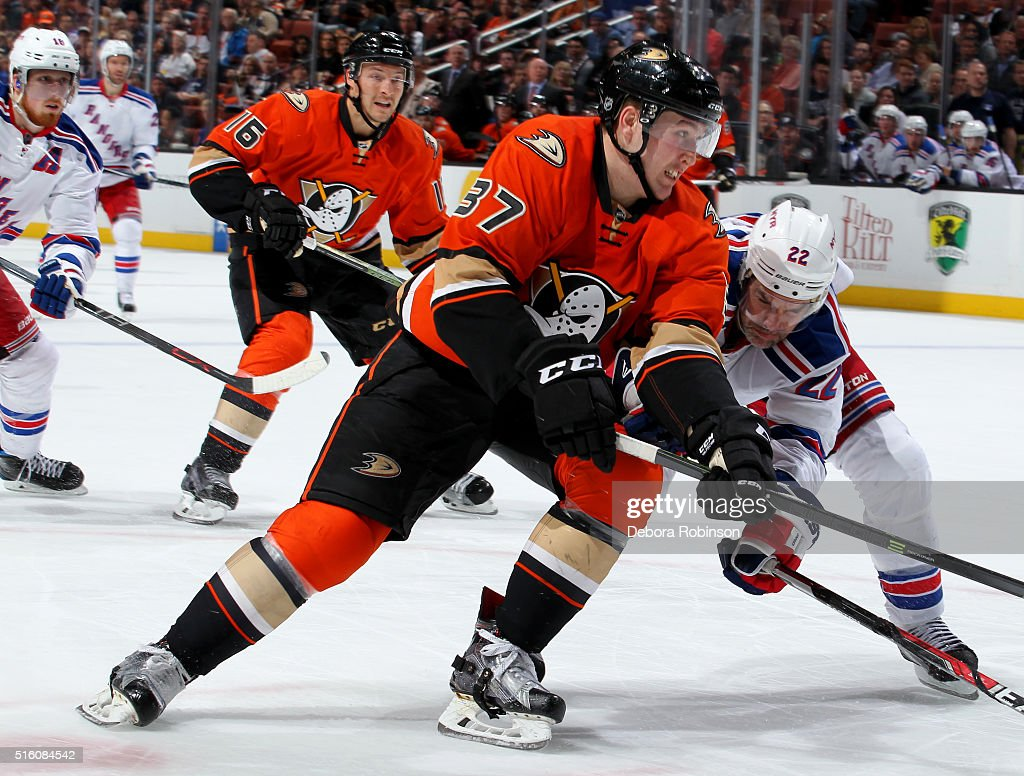 Nick Ritchie #37 of the Anaheim Ducks battles for position against Dan Boyle #22 of the New York Rangers on March 16, 2016 at Honda Center in Anaheim, California.