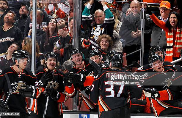 Nick Ritchie of the Anaheim Ducks celebrates his first NHL goal with his teammates during the game against the New Jersey Devils on March 14 2016 at...