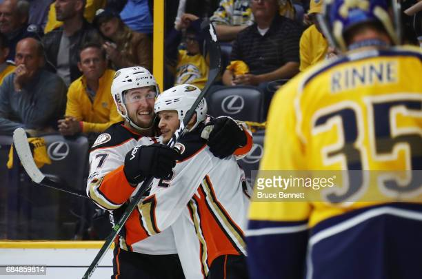 Nick Ritchie of the Anaheim Ducks celebrates with Kevin Bieksa after scoring a goal during the second period against Pekka Rinne of the Nashville...