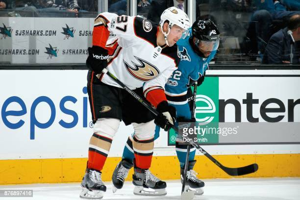 Nick Ritchie of the Anaheim Ducks defends Joel Ward of the San Jose Sharks at SAP Center on November 20 2017 in San Jose California