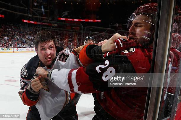 Nick Ritchie of the Anaheim Ducks fights with Jarred Tinordi of the Arizona Coyotes during the third period of the NHL game at Gila River Arena on...