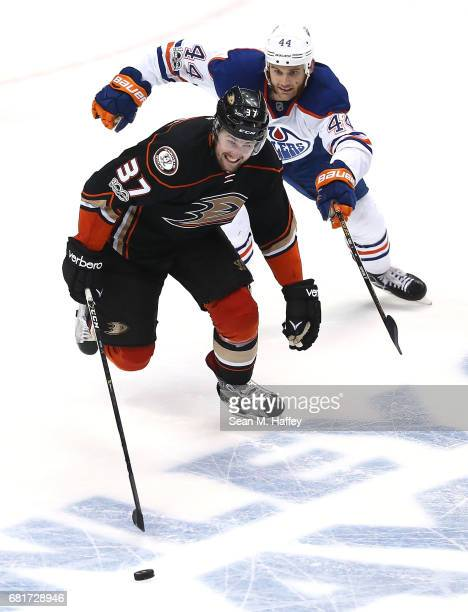 Nick Ritchie of the Anaheim Ducks skates against Zack Kassian of the Edmonton Oilers in Game Seven of the Western Conference Second Round during the...