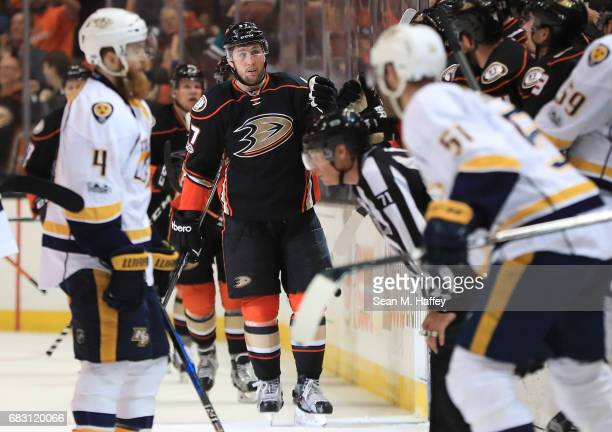 Nick Ritchie of the Anaheim Ducks skates by the bench to celebrate his goal with teammates Ryan Ellis of the Nashville Predators skates to the bench...