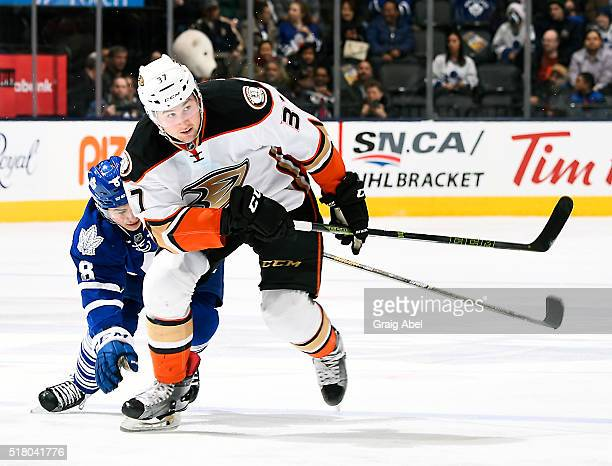 Nick Ritchie of the Anaheim Ducks skates up ice away from Connor Carrick of the Toronto Maple Leafsduring game action on March 24 2016 at Air Canada...
