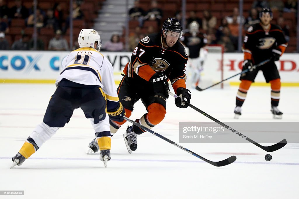 Nick Ritchie #37 of the Anaheim Ducks skates with the puck at Ryan Ellis #4 of the Nashville Predators during the third period of a game at Honda Center on October 26, 2016 in Anaheim, California.
