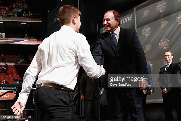 Nick Ritchie shakes hands with NHL commissioner Gary Bettman after being selected tenth overall by the Anaheim Ducks during the 2014 NHL Entry Draft...