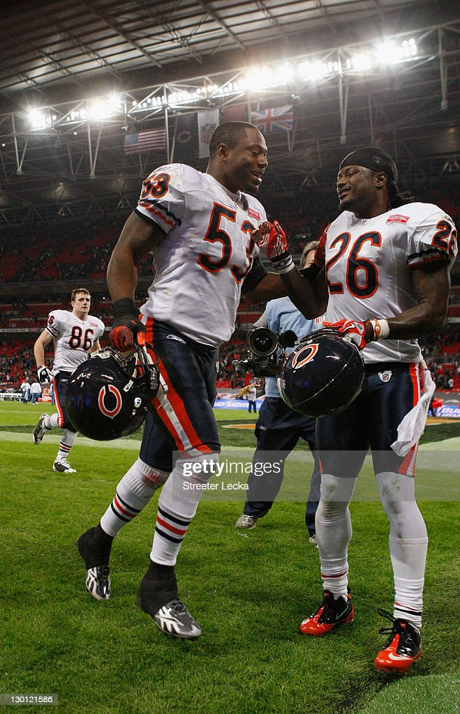Nick Roach #53 and <a gi-track='captionPersonalityLinkClicked' href=/galleries/search?phrase=Tim+Jennings&family=editorial&specificpeople=2081449 ng-click='$event.stopPropagation()'>Tim Jennings</a> #26 of the Chicago Bears leave the pitch after winning 24-18 in the NFL International Series match between Chicago Bears and Tampa Bay Buccaneers at Wembley Stadium on October 23, 2011 in London, England. This is the fifth occasion where a regular season NFL match has been played in London.