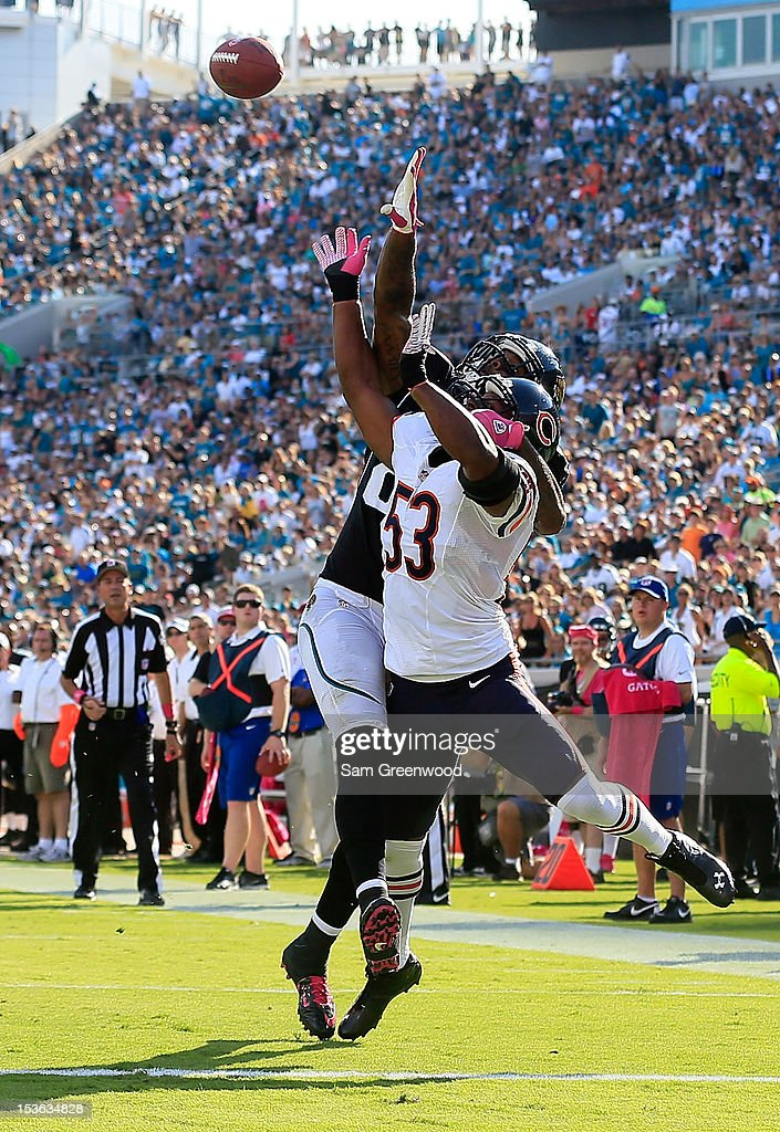 Nick Roach #53 of the Chicago Bears breaks a pass to <a gi-track='captionPersonalityLinkClicked' href=/galleries/search?phrase=Marcedes+Lewis&family=editorial&specificpeople=453286 ng-click='$event.stopPropagation()'>Marcedes Lewis</a> #89 of the Jacksonville Jaguars during the game at EverBank Field on October 7, 2012 in Jacksonville, Florida.