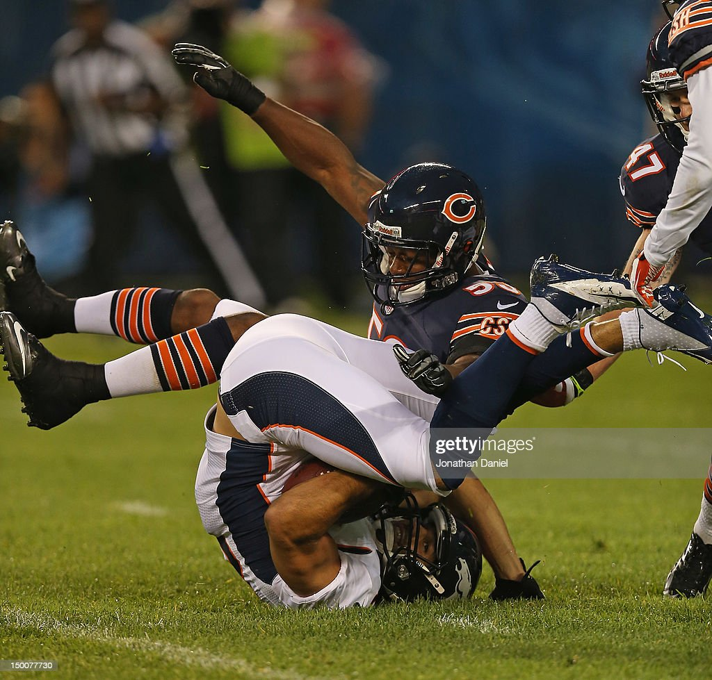 Nick Roach of the Chicago Bears brings down Eric Decker of the Denver Broncos during a preseason game at Soldier Field on August 9 2012 in Chicago...