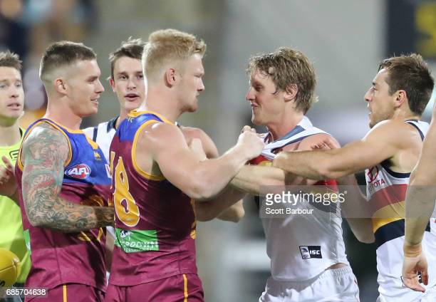 Nick Robertson of the Lions and Rory Sloane of the Crows wrestle before the first bounce during the round nine AFL match between the Brisbane Lions...