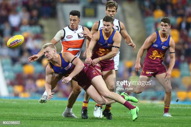Nick Robertson of the Lions handballs during the round 14 AFL match between the Brisbane Lions and the Greater Western Sydney Giants at The Gabba on...