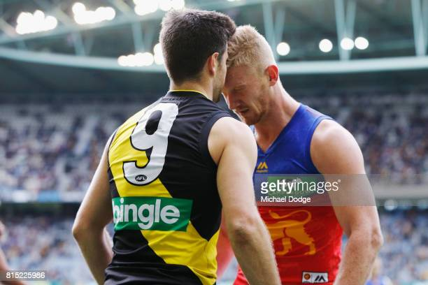 Nick Robertson of the Lions headbutts Trent Cotchin of the Tigers during the round 17 AFL match between the Richmond Tigers and the Brisbane Lions at...