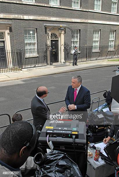 Nick Robinson Political Editor for the BBC talks to his colleague Huw Edwards presenter and newsreader outside 10 Downing Street on the day that...