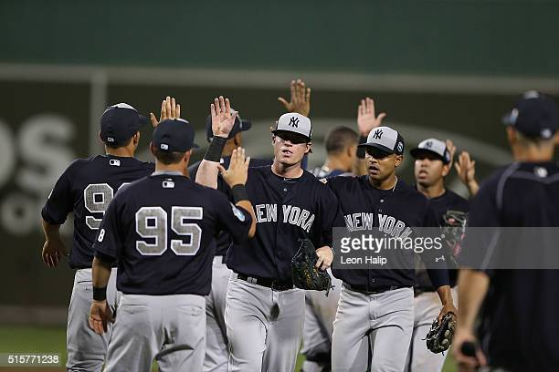 Nick Rumbelow of the New York Yankees celebrates a win over the Boston Red Sox with his teammate on March 15 2016 during the Spring Training Game at...