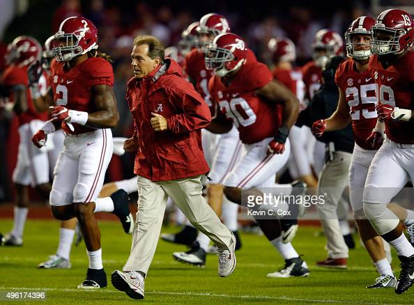 Nick Saban head coach of the Alabama Crimson Tide runs onto the field before playing against the LSU Tigers at BryantDenny Stadium on November 7 2015...