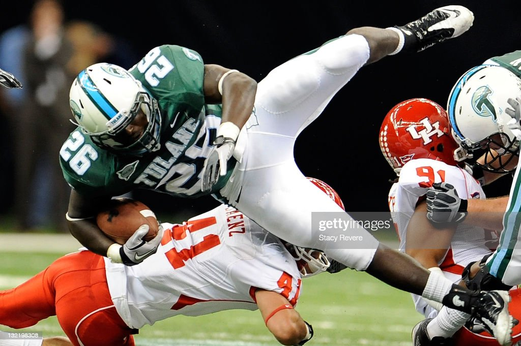 Nick Saenz #41 of the University of Houston Cougars tackles Orleans Darkwa #26 of the Tulane Green Wave during a game being held at the Mercedes-Benz Superdome on November 10, 2011 in New Orleans, Louisiana.